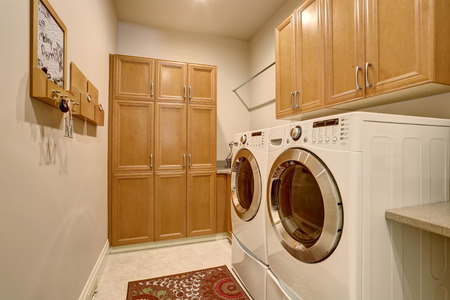 laundry room: Interior design of laundry room with modern appliances and cabinets. Northwest, USA Stock Photo