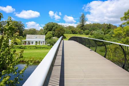 KERIKERI, NZ - JAN 10,2015: View of Kerikeri Mission Station park from a modern metal bridge. New Zealand Editorial