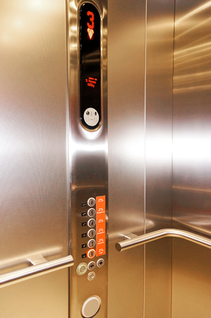 panels: Close up of stainless steel elevator panel push buttons. Monitor show number 3 floor in elevator Stock Photo