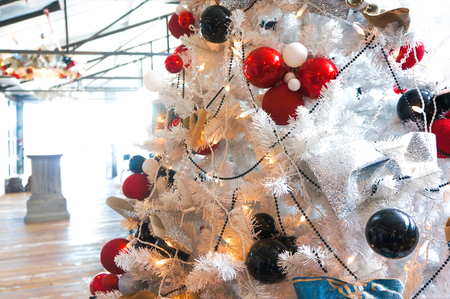 Christmas colorful balls on a white Christmas tree. Stock Photo