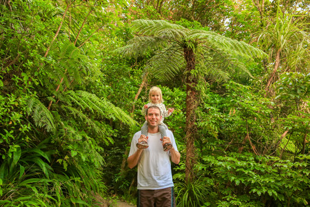 Young happy Father with little daughter on his shoulders. Mount Manaia. New Zealand