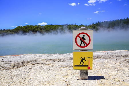 Champagne Pool, Wai-O-Tapu Thermal Wonderland, New Zealand. Lava volcanic landscape steam, warning sign,geothermal area