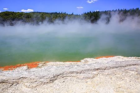 thermal spring: Wai-O-Tapu Thermal Wonderland inNew Zealand. Champagne Pool steam geothermal water lava crust