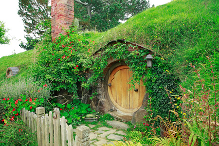 saga: MATAMATA, NEW ZEALAND - JANUARY 15, 2015: Hobbiton - movie set created for filming the Lord of the Rings. View of hobbit house.