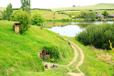 MATAMATA, NEW ZEALAND - JANUARY 15, 2015: Hobbiton - movie set created for filming the Lord of the Rings. View of hobbit house.
