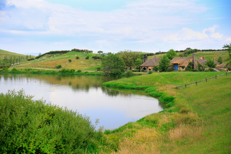 MATAMATA, NEW ZEALAND - JANUARY 15, 2015: Hobbiton - movie set created for filming the Lord of the Rings. View of pond with amazing landscape.