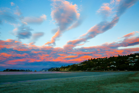 sunset sky: Amazing view of Colorful sunset sky with overcast clouds and picturesque scene at Wharariki Beach, Nelson, North Island, New Zealand Stock Photo