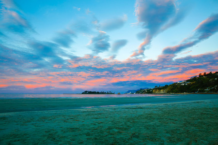 Amazing view of Colorful sunset sky with overcast clouds and picturesque scene at Wharariki Beach, Nelson, North Island, New Zealand Stok Fotoğraf