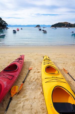 tasman: Two kayak boats, close up. Kaiteriteri beach.