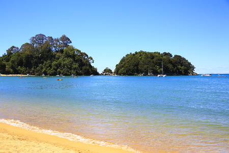 Beautiful orange beaches along the Abel Tasman Great Walk. Kaiteriteri beach. Gateway to Abel Tasman National Park.