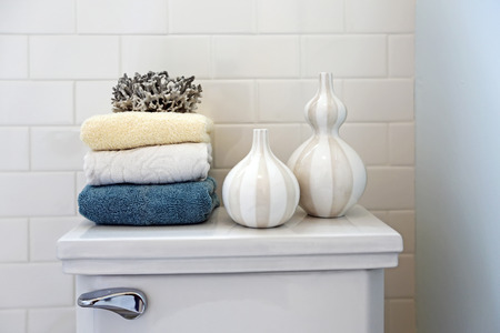 northwest: Stack of towels with liquid soap dispensers in a bathroom close up. Northwest, USA