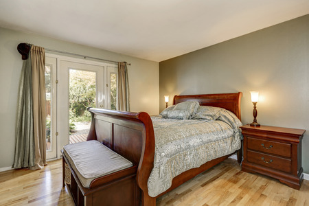 Simple yet luxurious man's bedroom with solid wood furniture. Northwest, USA