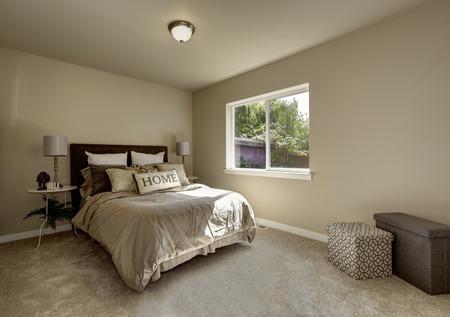 northwest: Light tones bedroom interior with large bed. Northwest, USA