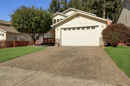 northwest: House exterior. Close up of garage door and driveway with stone tile. Northwest, USA
