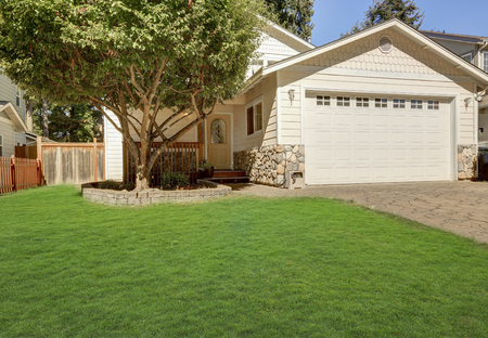 northwest: House exterior. Close up of garage door and driveway with stone tile. Entrance porch and natural stone trim. Northwest, USA