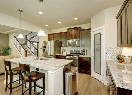 renovated: Classic kitchen room interior with large kitchen island with granite counter tops,  modern cabinets, stainless steel appliances and pantry. Northwest, USA Stock Photo