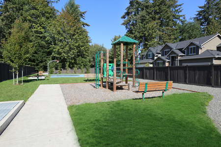 New playground in modern family friendly residential area in the suburban area. Northwest, USA