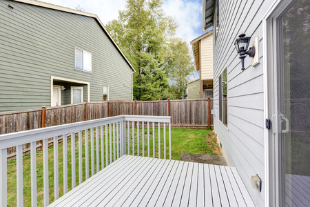 neighboring: Empty wooden backyard deck overlooking neighboring houses in Tacoma. Northwest, USA