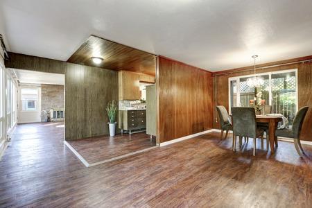 open floor plan: House interior. Open floor plan with hardwood floors in dining room, kitchen and living room. Northwest, USA Stock Photo