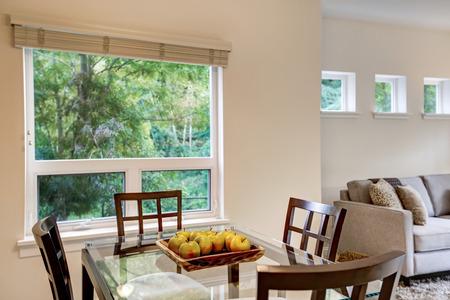 northwest: Fresh apples on modern dining table . Apartment interior. Northwest, USA