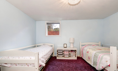 furnished: Pale blue walls and burgundy carpet of kids bedroom with two beds. Northwest, USA