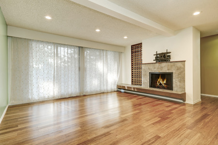 unfurnished: Apartment unfurnished living room interior with fireplace and polished hardwood floor. Northwest, USA