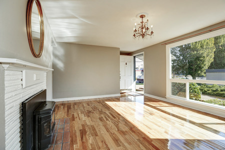 empty room: Bright sunny empty living room and entryway interior. Northwest, USA