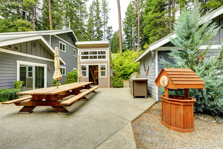 Exterior of American gray home. Spacious patio area with barbe?ue. Northwest, USA Stock Photo
