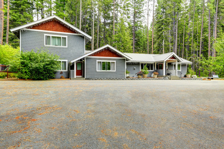 Custom built suburban house in the wood with wide concrete driveway. Northwest, USA Stock Photo