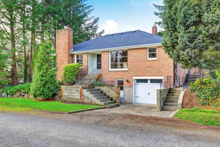 two story: American red brick two story house exterior with garage and well kept garden around. Northwest, USA