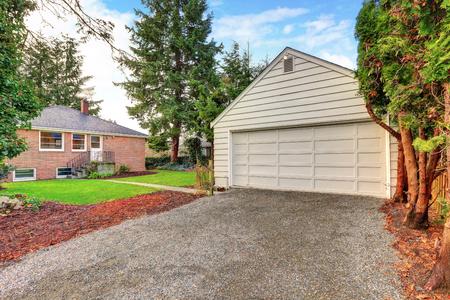 Detached garage of the red brick house. Northwest, USA