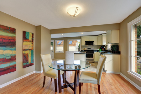 Modern dining area with glass table. Hardwood floor. Northwest, USA