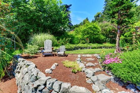 Luxury single family house exterior with natural stone landscape design. Northwest, USA