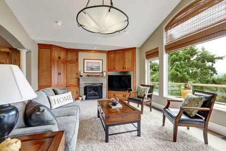 classic living room: Classic living room interior with large windows in luxurious house.  Northwest, USA