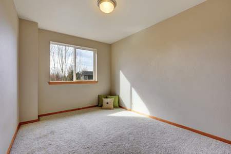 remodeled: Empty room interior with pillows on carpet floor. Northwest, USA