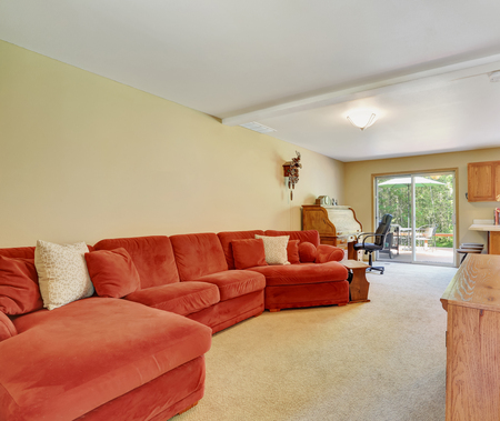 extra large: Interior of family room with extra Large red sofa. Northwest, USA