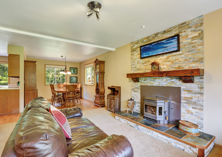 interior wall: Living room interior with retro details, stone brick wall with fireplace and leather sofa. Northwest, USA
