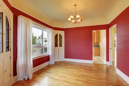 Empty red dining room interior with built-in cabinets, hardwood floors . Northwest, USA Stock Photo