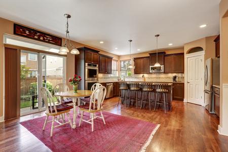 Cozy kitchen and dining room interior with hardwood floor. Northwest, USA