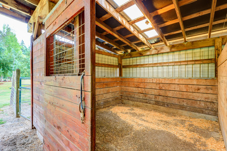 Empty stable in wooden horse barn. Northwest, USA