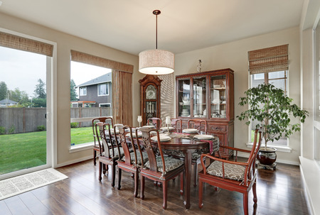 Classical interior of dining room in luxurious house with vintage furniture and hardwood floors. Northwest, USA