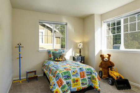 Cheerful boys room with colorful bed and toys. Northwest, USA Stock Photo