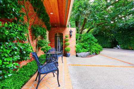 front yard: Brick paved walkway leading to the front yard. Luxury house exterior. Northwest, USA