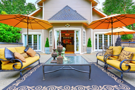 View of luxury house back yard with beautiful statues and cozy seating arrangement. Northwest, USA