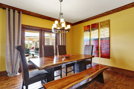 eating area: Dining room interior. Rustic wooden table, bench and high-back chairs. Northwest, USA