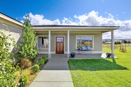 northwest: Covered entrance porch with concrete floor and columns. Northwest, USA