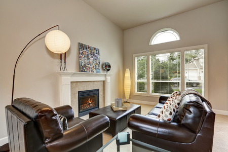 green couch: Family room interior with leather sofa set, fireplace and nicely designed floor lamps. Northwest, USA