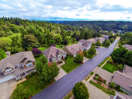 residential houses: Aireal view of American suburban residential houses with perfect forest landscape. Northwest, USA Stock Photo