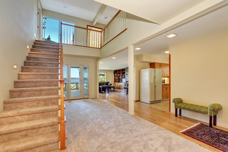 halls: Hallway interior with staircase leading upstairs, comfortable green bench by the wall and exit to the back deck. Northwest, USA