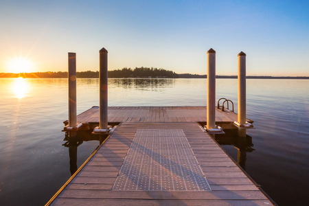 spring water: Wooden pier on lake sunset and sky reflection water. Northwest, USA